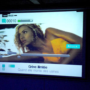 A karaoke screen displays Beyonce and some strange lyrics, likely to be transformed from the originals.
